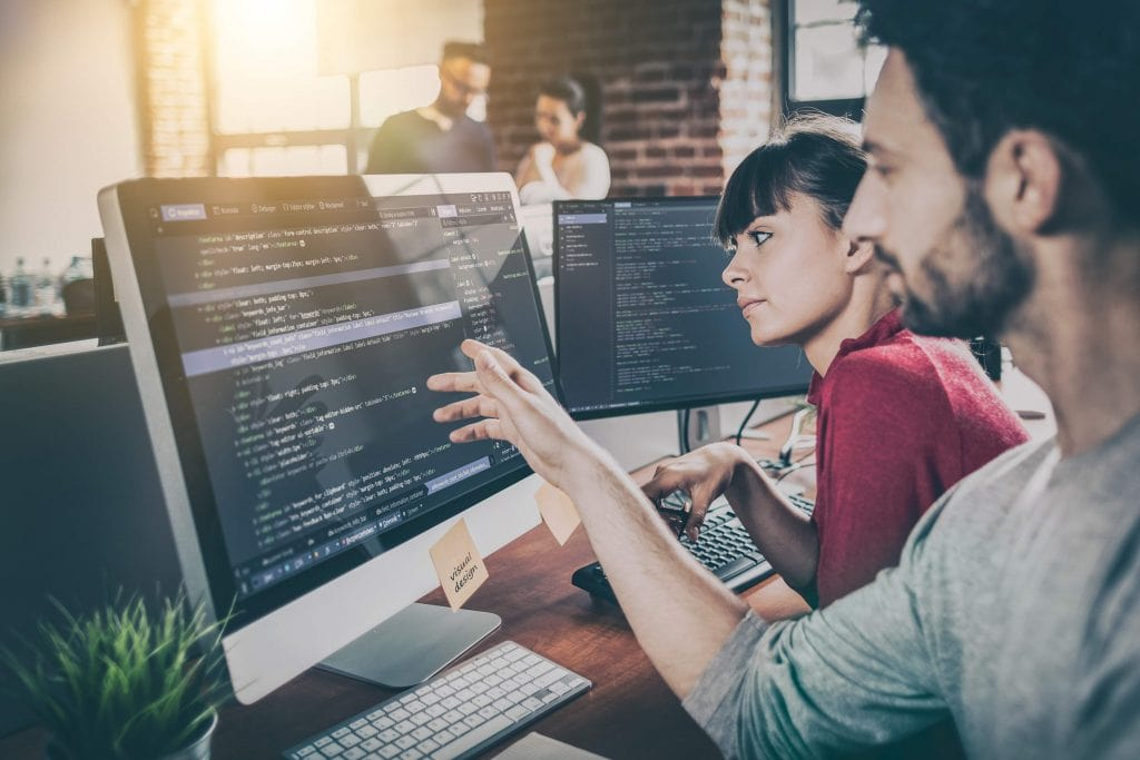 affiliate program manager team huddling around laptop results